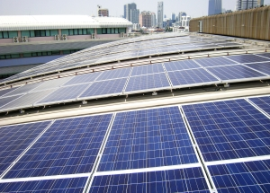 Rooftop Solar Panels on Factory Roof
