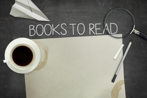 Books to read concept on blackboard with empty paper sheet